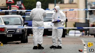 Forensic officers at the scene after the collision