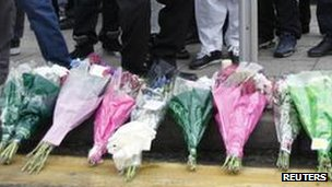 Flowers and candles at the scene