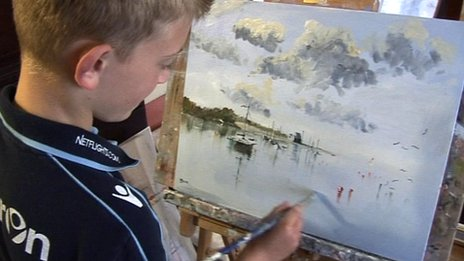 Kieron Williamson and one of his paintings
