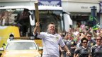 Steve Backley runs with the Olympic flame in Margate