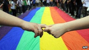 Gay and lesbian activists march with a rainbow flag in Hong Kong (file photo)