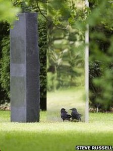 Crow with sculpture