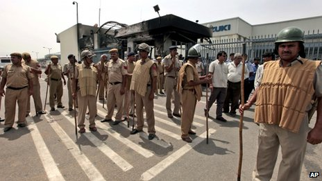 Policemen outside the Maruti Suzuki factory in Manesar