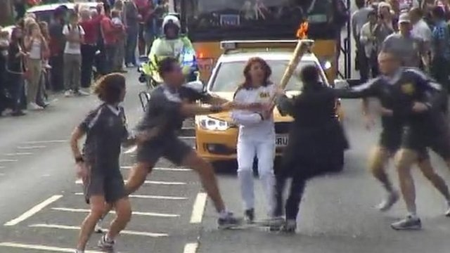 Officers tackle teenager as he tries to grab the Olympic torch in Gravesend, Kent