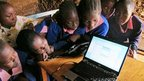 Pupils from Makina cluster around their laptop during the 'inspiration' debate!
