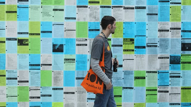A visitor looks at printouts of the day's tweets during the 2012 re.publica conferences on May 2, 2012 in Berlin, Germany