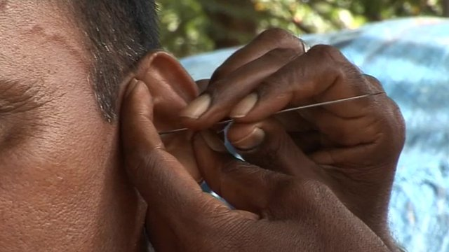 Ear being cleaned