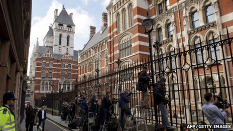 Journalists stand behind the railings waiting the arrival of British Prime Minister David Cameron to give evidence at the Leveson Inquiry into media ethics at the High Court in London on June 14