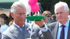 The Prince of Wales tries plate-spinning in Guernsey