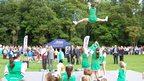 The Prince of Wales observes a cheerleading display in Guernsey