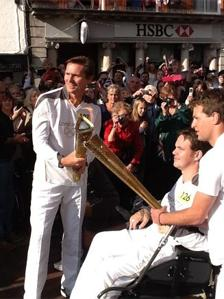 Roger Black being handed the flame
