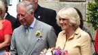 The Prince of Wales and the Duchess of Cornwall outside Alderney's Island Hall