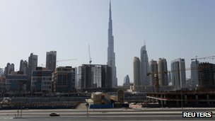 Construction cranes are seen near Burj Khalifa (June 2012)