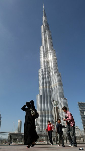 A woman walks in front of the Burj Khalifa tower (June 2010_