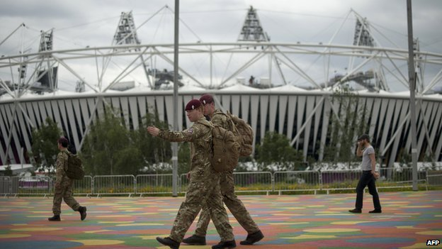 British military personnel walk past the Olympic Stadium ahead of the London 2012 Olympic Games