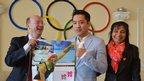 Derek and Rekha share a joke with Enkhbatyn Badar-Uugan at the Mongolian Olympic HQ.