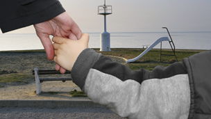 child holding parent&#039;s hand 