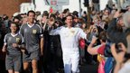 Roger Black carries the Olympic flame between Shere and Godalming