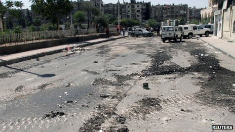 Tank tracks are seen on a street at al-Midan neighbourhood in Damascus July 20, 2012.
