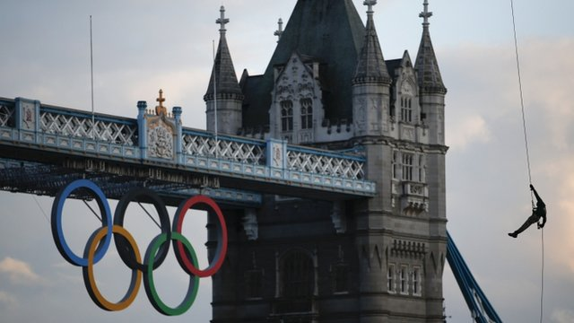 Royal Marine abseils into Tower of London carrying Olympic flame