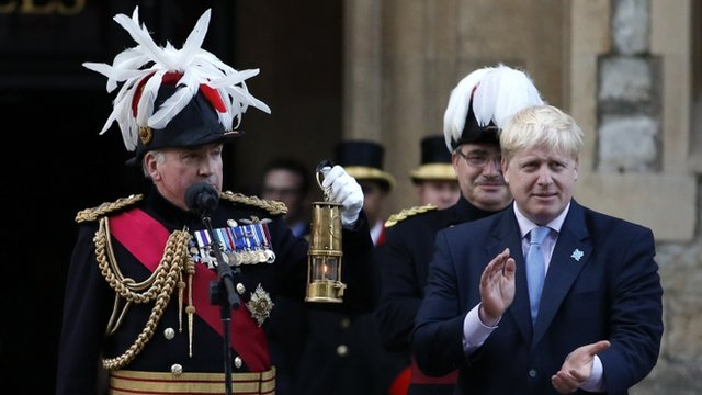 Lord Richard Dannatt, Constable of the Tower of London, holds the Olympic flame, accompanied by Boris Johnson