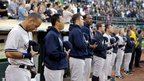 Members of the New York Yankees baseball team observe a moment of silence for the shooting victims of Aurora, Colorado (20 July 2012)
