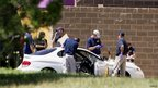 Police investigate the car belonging to the Aurora cinema shootings gunman James Holmes (20 July 2012)