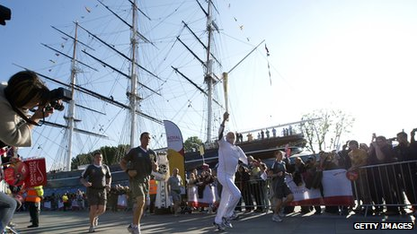 Around the world sailor Sir Robin Knox-Johnston carries the flame at the Cutty Sark