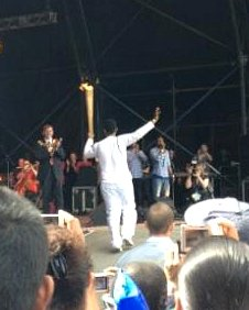 The torch being carried onto the stage at Newham