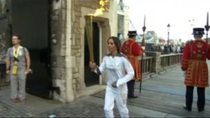 Dame Kelly Holmes with the Olympic torch at Tower Bridge, London