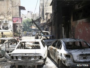 Burned-out cars in the Midan district of Damascus (20 July 2012)