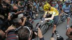 Photographers crowd around cyclist Bradley Wiggins before the 17th stage of the Tour de France