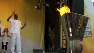 Fabrice Muamba with Olympic torch