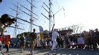 British sailor Robin Knox-Johnston carried the flame in front of the Cutty Sark
