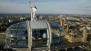 Amelia Hempleman-Adams on top of the London Eye with the flame