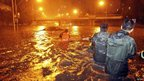 A flooded street under the Guangqumen overpass, Beijing, 21 July
