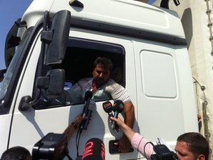 Lorry driver talks to reporters at the Cilvegozu border crossing