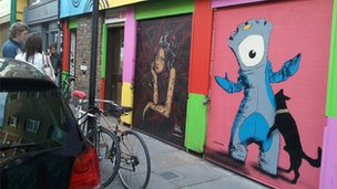 Street art with an Olympic theme on Brick Lane