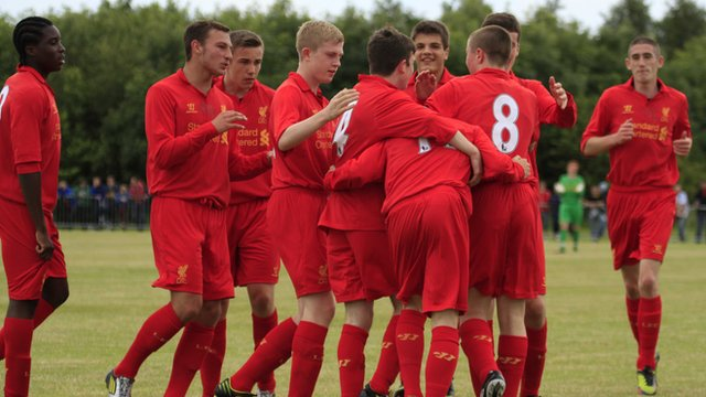 Liverpool players celebrate their victory over County Antrim