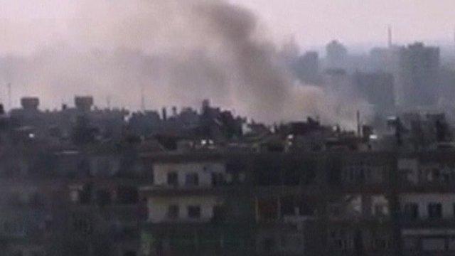 Smoke rises over Damascus