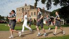 David Backhouse carried the Olympic flame past Valentine's Mansion in Ilford