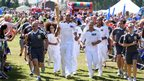 Britain's Got Talent winners Diversity ran as a group of torchbearers at Barking & Dagenham's Central Park. Ashley Banjo, the leader of the dance group, is pictured here carrying the flame before they all performed on stage as as part of the 60th Dagenham Town Show.