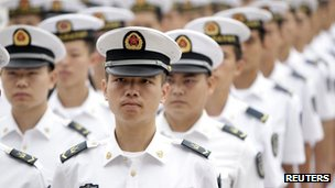 Chinese People's Liberation Army (PLA) navy sailors stand in a line and wait to attend a ceremony at the Great Hall of the People in Beijing, 19 July, 2012