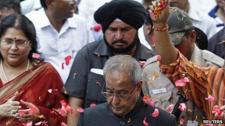 Supporters throw petals on Pranab Mukherjee in Delhi on 22 July 2012
