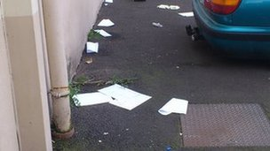 The documents were strewn across the street in Londonderry
