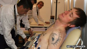 Bradley Wiggins having medical tests with his Prodigy-esque tattoo