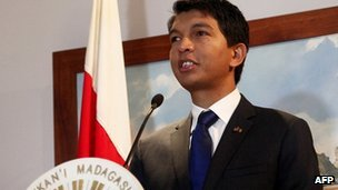 Madagascar's leader Andry Rajoelina gives a press conference on 23 July 2012 prior to leaving for the Seychelles for face-to-face talks with his ousted rival Marc Ravalomanana