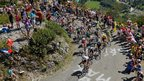 Team Sky lead the peloton up the Col du Grand Colombier