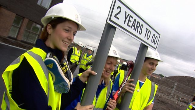 Athletes hold a 'Two years to go sign' in Glasgow