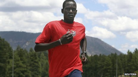 Guor Marial, 28, runs along a street in Flagstaff, Arizona, on 21 July  2012